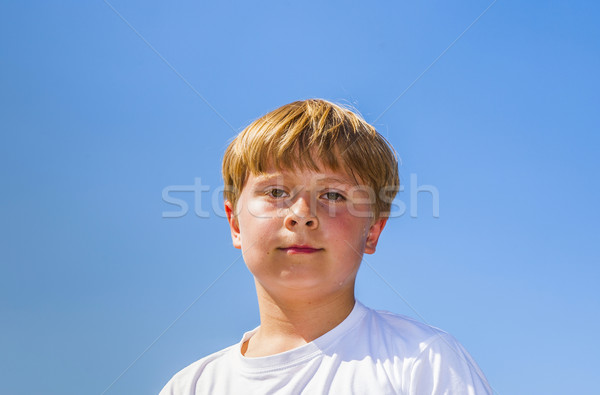 happy boy is smiling, sweating from sports and enjoying life Stock photo © meinzahn