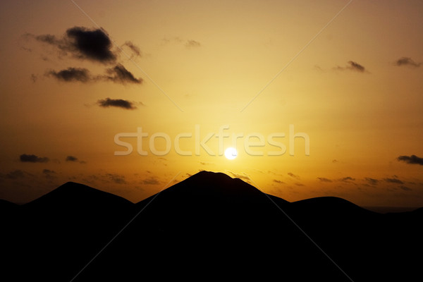volcano landscape at sunset, national parc of Timanfaya in Lanza Stock photo © meinzahn