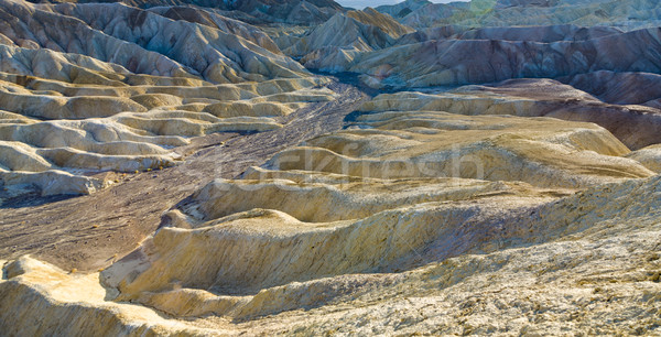 Stock photo: Picturesque soft waves from multi-coloured sandstone. Death vall