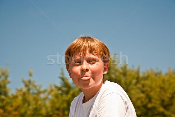 happy boy is smiling and enjoying life Stock photo © meinzahn