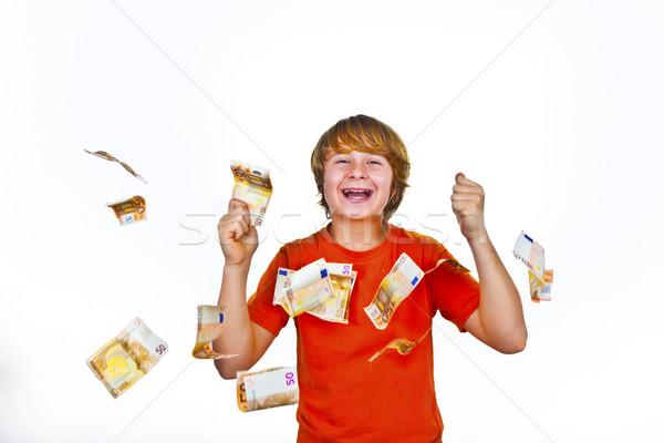 Euros voador em torno de meninos cabeça cara Foto stock © meinzahn