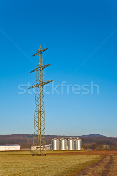 beautiful landscape with silo and electrical tower with blue sky Stock photo © meinzahn