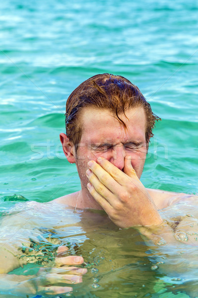 teenage boy blows his nose of saltwater Stock photo © meinzahn
