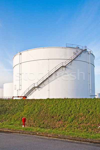 white tanks for petrol and oil in tank farm with blue sky Stock photo © meinzahn
