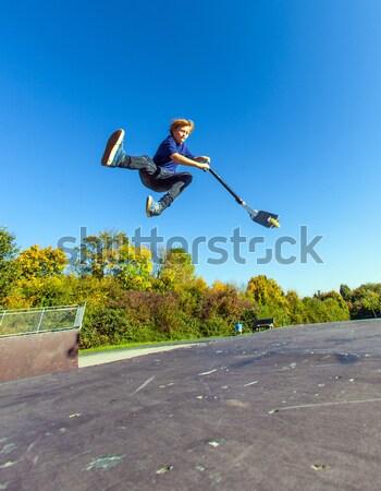 Fiú ugrik moped korcsolya park gyerekek Stock fotó © meinzahn