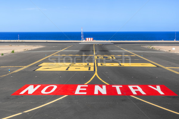 no entry sign at the runway of the airport with ocean in backgro Stock photo © meinzahn