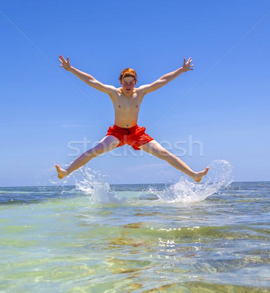 handsome boy  jumps in the air  Stock photo © meinzahn