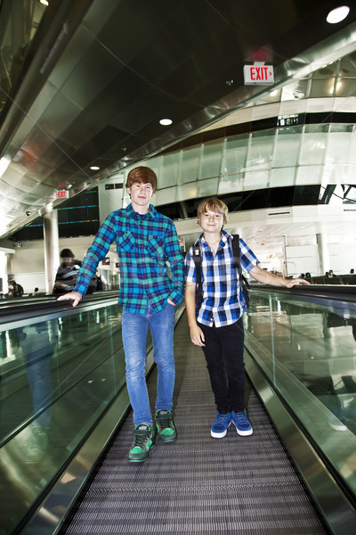 young boys on a moving staircase inside the airport Stock photo © meinzahn