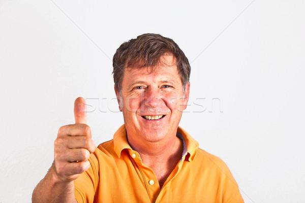 attractive man giving finger sign Stock photo © meinzahn