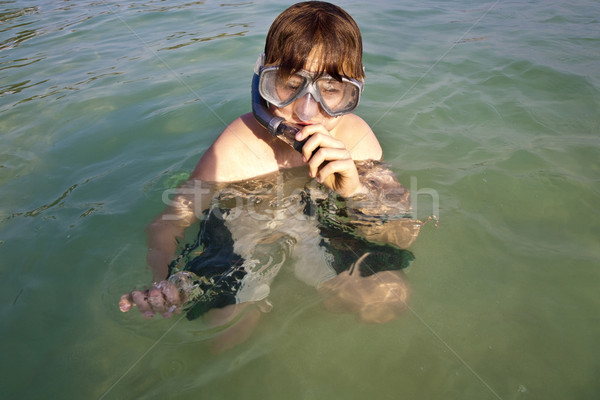 young boy likes to snorkel in the clear water  Stock photo © meinzahn