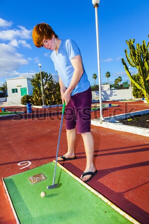boy playing mini golf in the course Stock photo © meinzahn