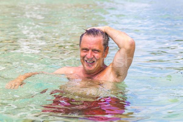 Homme amusement natation océan bel homme plage Photo stock © meinzahn