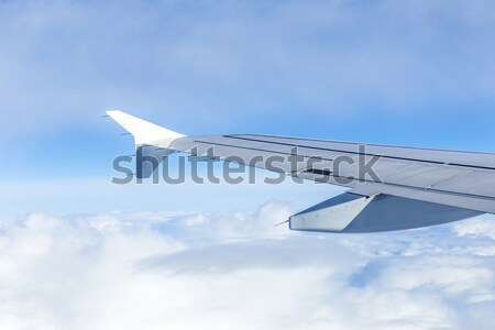 wing of aircraft in blue sky Stock photo © meinzahn