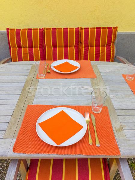 tableclothes at a teak table in the garden Stock photo © meinzahn