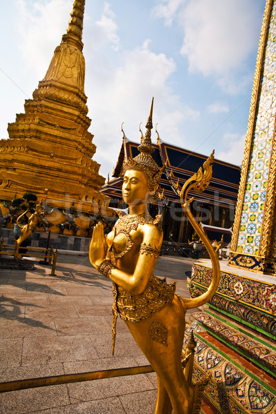 famous temple Phra Sri Ratana Chedi covered with foil gold in th Stock photo © meinzahn