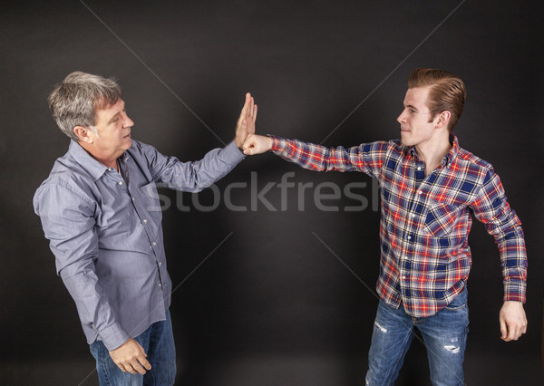 Stock photo: father and son lean on back to back