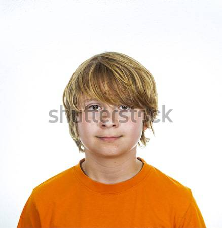 cute smiling boy in studio  Stock photo © meinzahn