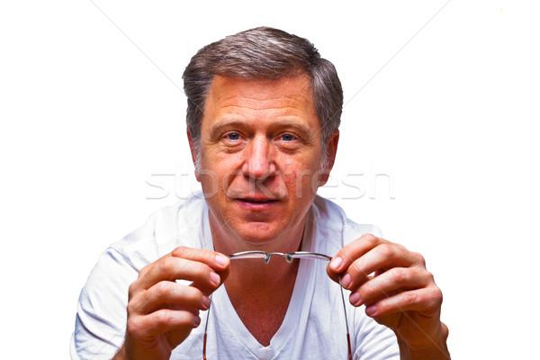 Férfi olvasószemüveg mosolyog mosoly arc szemek Stock fotó © meinzahn