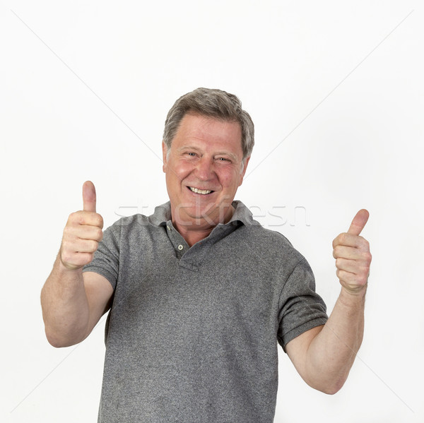smiling mature man with grey polo shirt Stock photo © meinzahn