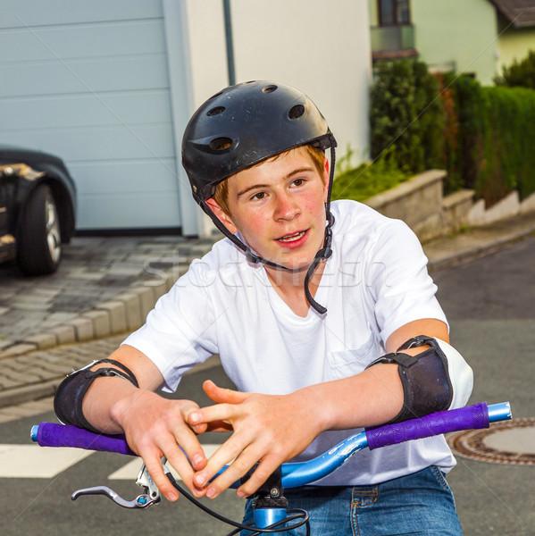 happy smiling  boy with helmet on his bike Stock photo © meinzahn