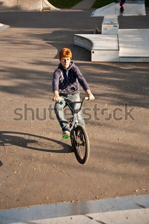joung boy with his mountainbike trains BMX tricks in the halfpip Stock photo © meinzahn
