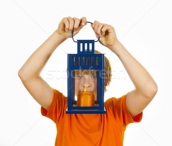 cute boy holding a hand lantern Stock photo © meinzahn