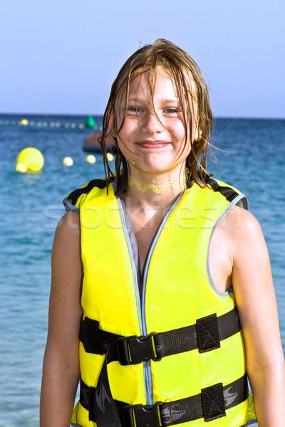 Ragazza vita gilet spiaggia sorridere bambino Foto d'archivio © meinzahn