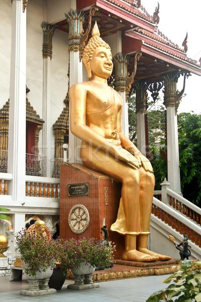 sitting Buddah in a temple in Bangkok Stock photo © meinzahn