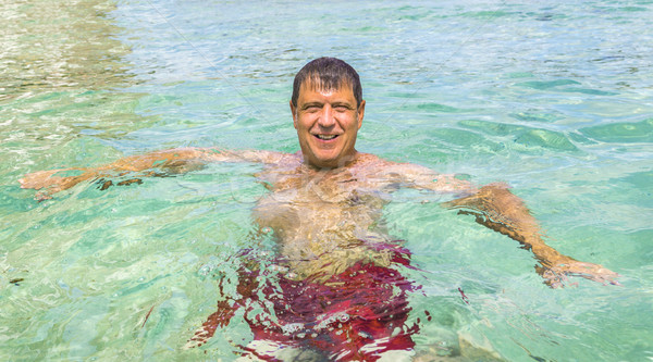 Man leuk zwemmen oceaan knappe man strand Stockfoto © meinzahn