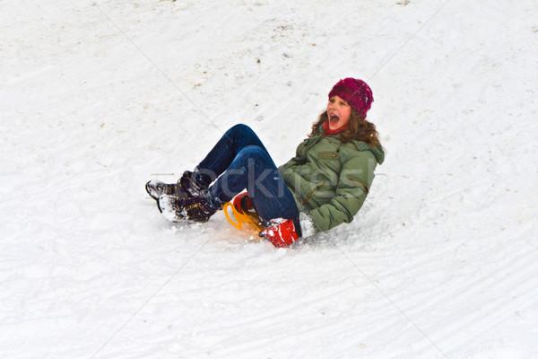 Nina trineo abajo colina nieve hermosa niña Foto stock © meinzahn