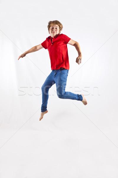 Cute chłopca skoki powietrza dzieci twarz Zdjęcia stock © meinzahn