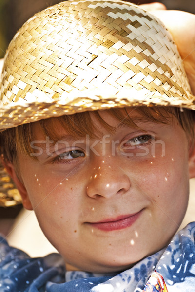 young boy with straw hat is happy and smiles Stock photo © meinzahn