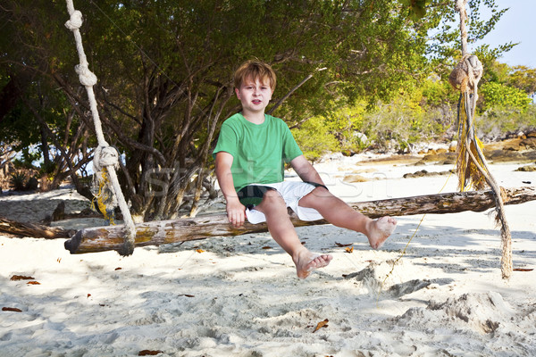 Garçon séance Swing plage arbres sourire Photo stock © meinzahn