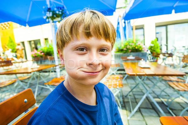 happy smiling child enjoys eating Stock photo © meinzahn