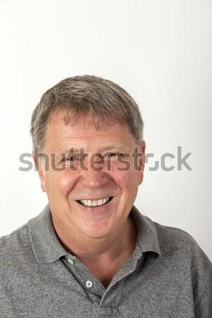 Portre yakışıklı adam okuma gözlükleri mutlu model arka plan Stok fotoğraf © meinzahn