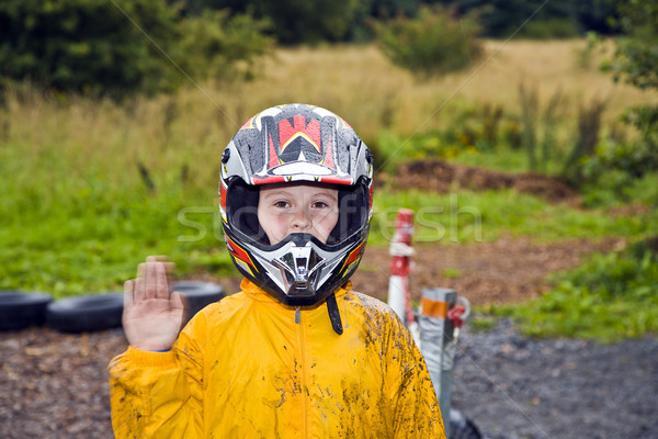 happy boy with helmet at the kart trail Stock photo © meinzahn