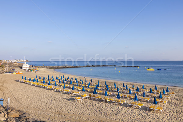 Playa de arena manana playa paraguas hermosa cielo Foto stock © meinzahn