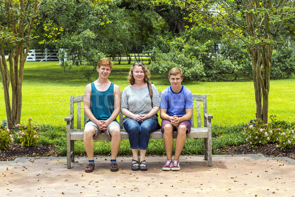 happy family sits in the garden at a bench  and enjoys nature Stock photo © meinzahn