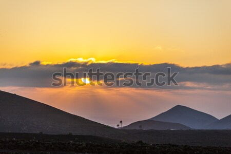 spectacular sunset over the volcanic mountains in Lanzarote Stock photo © meinzahn