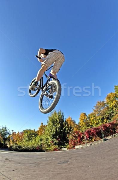 boy going airborne with his dirt bike Stock photo © meinzahn