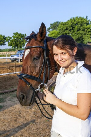 female rider hugging with her horse Stock photo © meinzahn