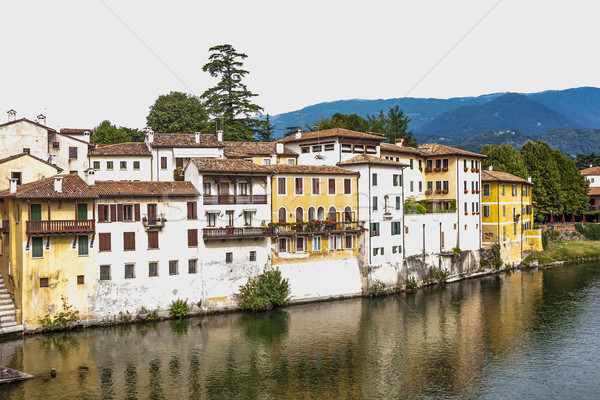facade of houses at river brenta with village Basano del Grappa Stock photo © meinzahn