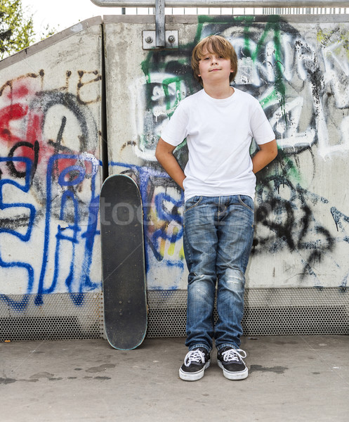 boy relaxes with his skate board at the skate park Stock photo © meinzahn