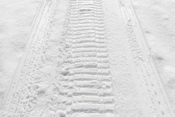 Trail of wheel in fresh snow Stock photo © meinzahn