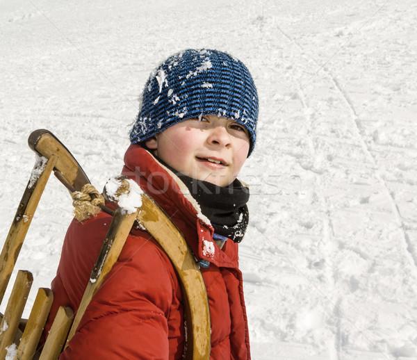 Chłopca sanki w górę Hill zimą dzieci Zdjęcia stock © meinzahn