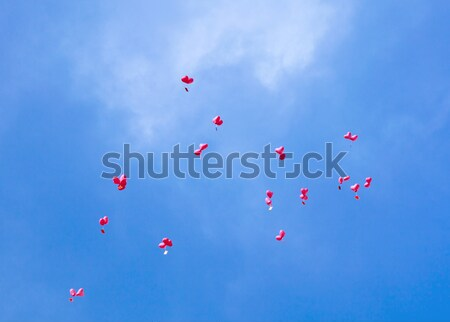 Red balloons with the messages in the blue sky  Stock photo © meinzahn