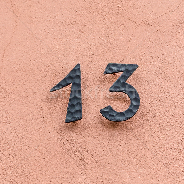 house number thirteen at a pink wall Stock photo © meinzahn