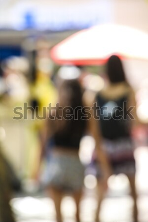 defocused wiew of women walking in the street in summer Stock photo © meinzahn