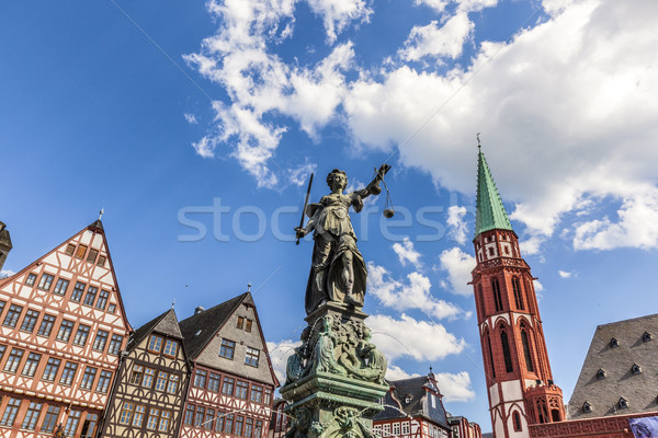 lady Justice at roemerberg in Frankfurt with half timbered house Stock photo © meinzahn