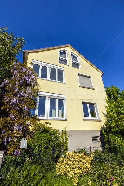 old house with yellow facade and green garden Stock photo © meinzahn